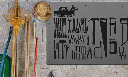 Tool Themed Stickers On A Tool Shed Wall